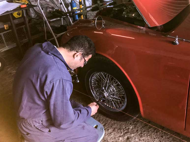 Yaser working on the Jaguar Mk2 suspension set up
